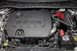 Spectre Performance 2009-2014 Toyota Corolla 1.8L air intake includes a conical filter, polished intake tube, and a powder coated filter heat shield