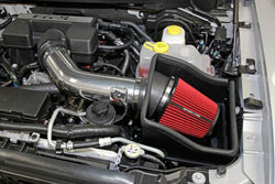 The Spectre 9977 intake has a red air filter, aluminum tube, and heat shield.