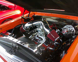 A Spectre Performance dual plenum intake system sits atop a Demon 650 carburetor feeding fuel and air into the 350 Chevy Small Block