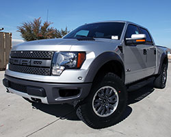 F-Series pickups, like this 2011 Ford F150 SVT Raptor with a 6.2L V8 engine can receive increased airflow and performance from a Spectre HPR filter