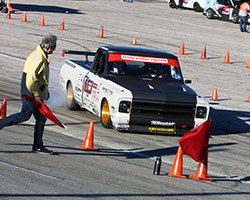 The OUSCI speed stop is Brandy Phillips' least favorite part of the OUSCI because the PCH Rods 1972 Chevy C10 R tends to lock up the rear wheels