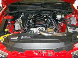 Wally Olczak showing off his Spectre air intake and the engine of his 2006 Pontiac GTO