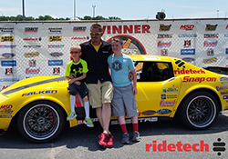 Chris Smith with his sons Colin and Jason in the winner's circle during the Goodguys' East Coast Nationals