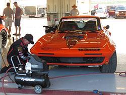 Greg Thurmond working on his 1965 Chevy Corvette