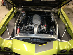 Johnson designed a dual Spectre air filter intake system using several Spectre components for his 1972 Camaro at SEMA