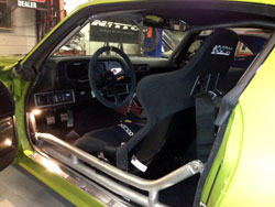 SEMA featured 1972 Camaro is equipped with custom seats, steering wheel, Tiger Cage, Autometer guage, shifter, shifter boot, floor pedals, rear view mirror, fire extinguisher and more