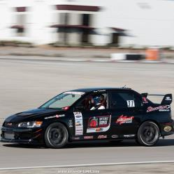 Driver side view of Ken Twhaits behind the wheel at Las Vegas Motor Speedway for OUSCI