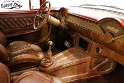 1955 Chevy Nomad passenger side interior shot featuring custom leather seats, console and dash pa