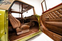 1955 Chevy Nomad interior featuring door panel, seats, carpet and dash