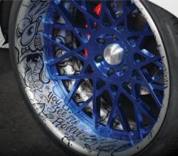 The secondary color of blue appears on the wheels as well as in the interior.