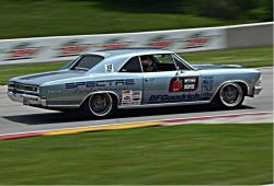Passenger side view of Chris Jacobs on the road course at Road America