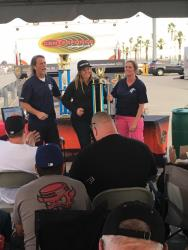 Rob and Trish Byrd present Brandy Phillips with Hotchkis Cup Truck Class Trophy
