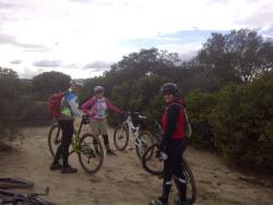 Mary featured here with friends on mountain bikes on a Salinas trail.