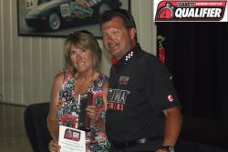 Mary Pozzi and Optima Series Race Director, Jimi Day, as he presents her with the OUSCI Invite