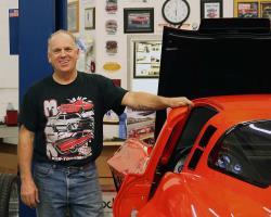 Greg Thurmond standing next to his '65 Corvette
