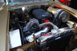 Vortec motor with electric helper motor