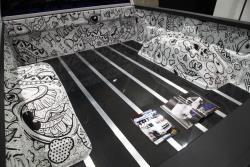 Custom hand drawn cartoons in bed of Chevy Silverado