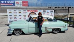Lynda Jacobs featured next the the '54 Chevy she won with at the Goodguys Lone Star Nationals
