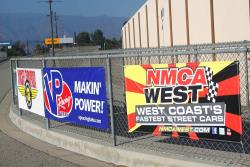 Event and Vendor banners at Autoclub Speedway, adjacent the sound wall.