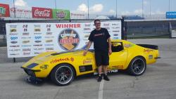 Photo of Chris Smith in front of the Goodguys Winner banner at the Lone Star Nationals in Texas