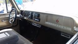 The interior is clean and simple with a bench seat out of a 1995 Silverado and a new steering column