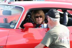 Husband David Pozzi seen coaching Mary as she sits in the driver's seat.