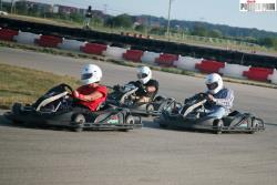 Mary, ahead of her friends and fellow competitors out on the go kart track.