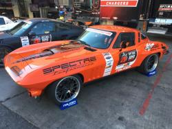 SHot of the 1965 Candy Tangerine Chevrolet Corvette owner/driver by Greg Thurmond in Optima Alley